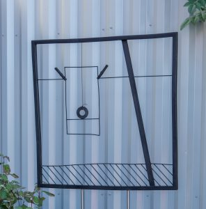Steel sculpture representing a drawing on paper pinned on a clothes line