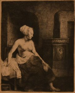 Rembrandt print of a woman by a stove