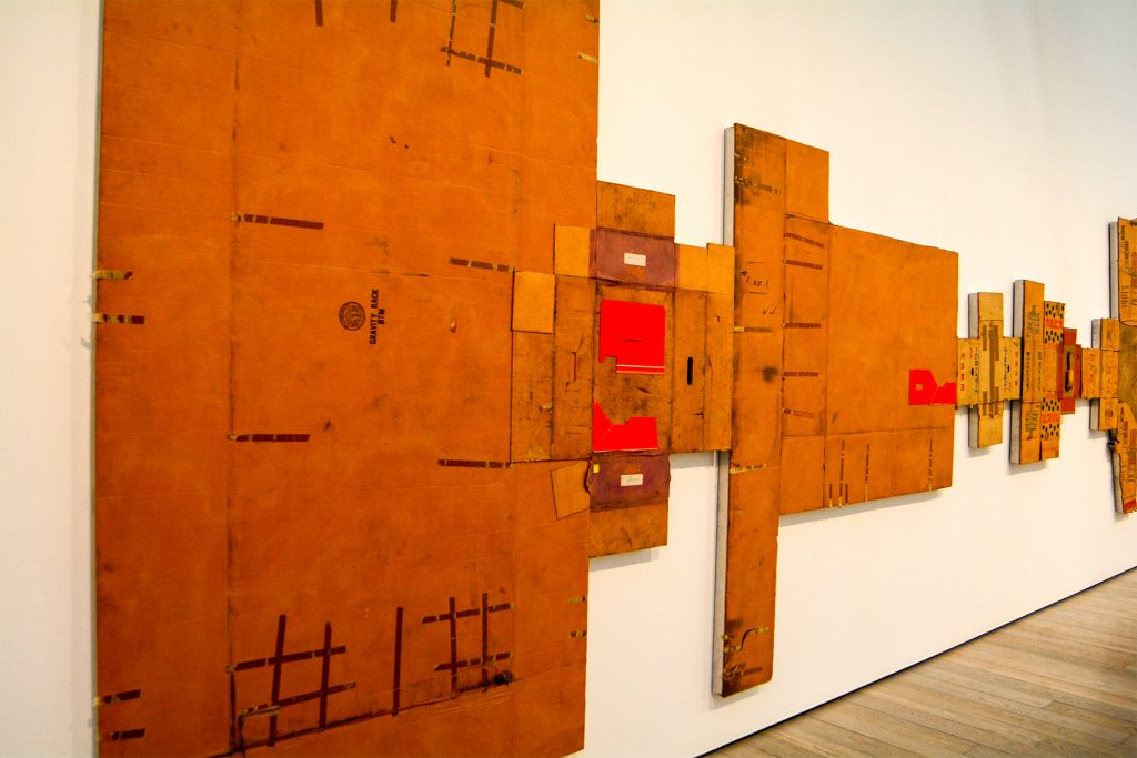 panel of 1/4 Mile painting by Robert Rauschenberg with cardboard boxes